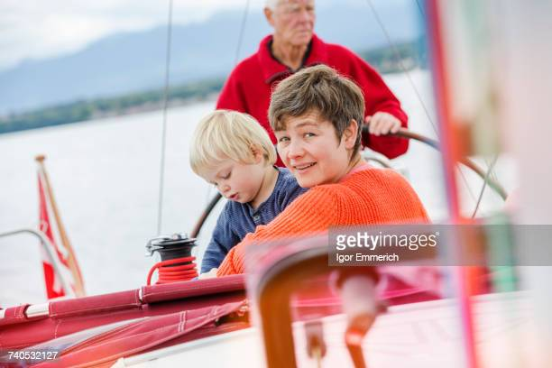 Three generation family on sailing boat, Geneva, Switzerland, Europe