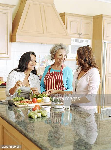Three generation family preparing food in kitchen