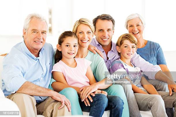 Three Generation Family Smiling At Home