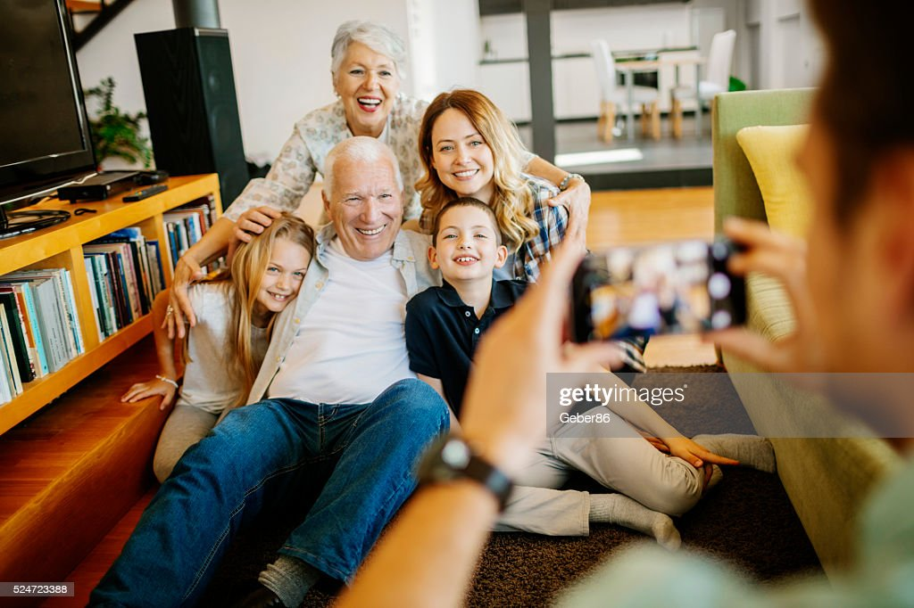 Three generation family taking photo of themselves : Stock Photo