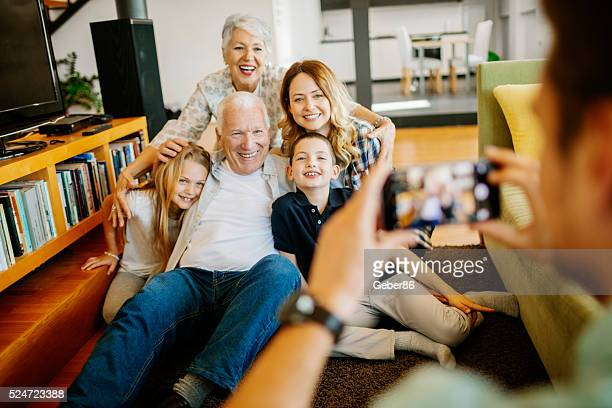 Three generation family taking photo of themselves