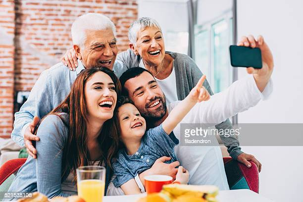 Three generation family taking selfie