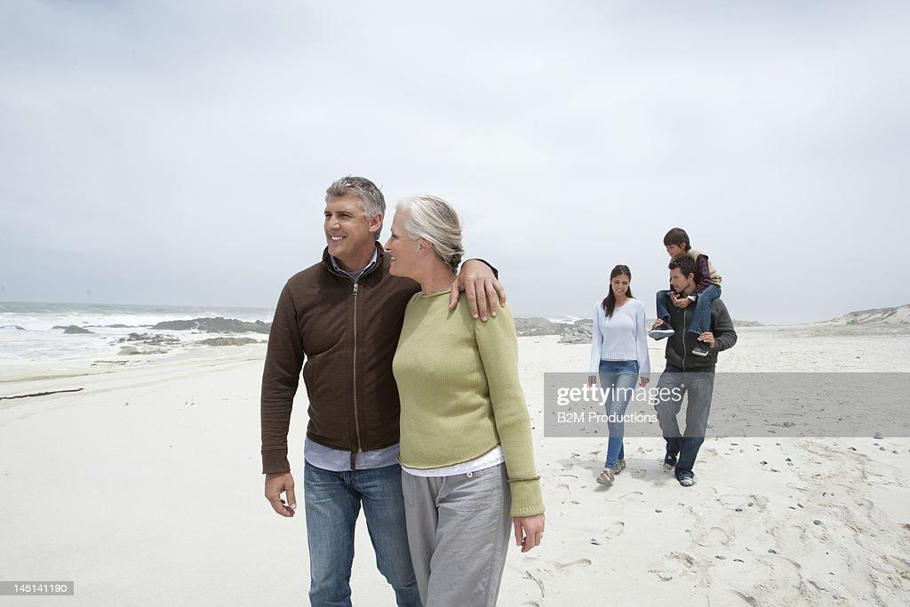 Three generation family walking on the beach : Stock Photo