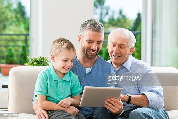 Three generation family with digital tablet