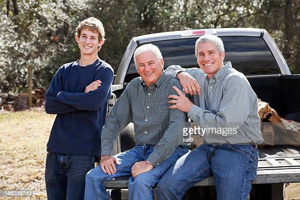 Three generation family with pickup truck