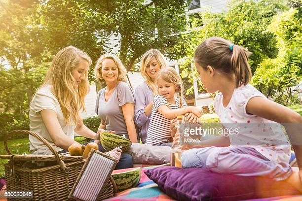 Three generation of women having picnic