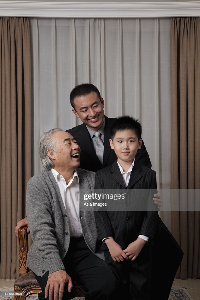 Three generation portrait of grandfather, father and son : Stock Photo