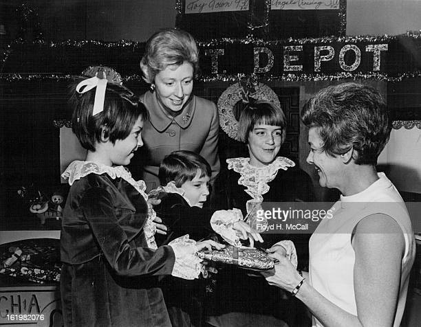 DEC 10 1969 DEC 12 1969 Three Generations Attend Tea at Tammen Hall Wednesday was the day for the annual Toy Train Tea sponsored by the Children's...