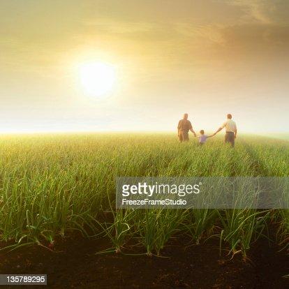 Three generations in farm field