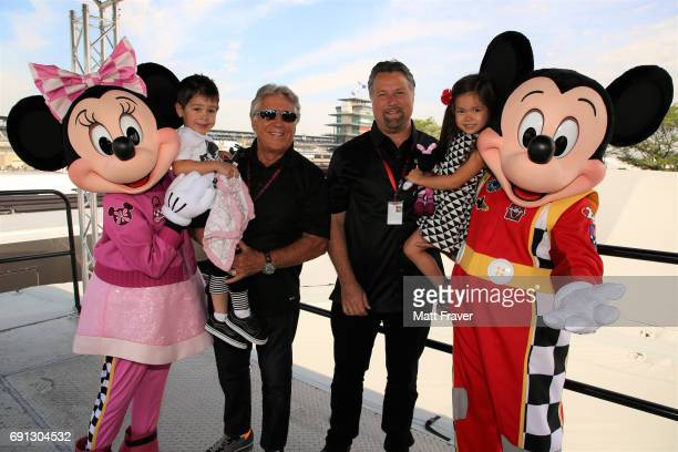 RACERS Three generations of Andretti's patriarch and former Indy 500 winner Mario Andretti son Michael and his children welcomed Mickey Mouse and...