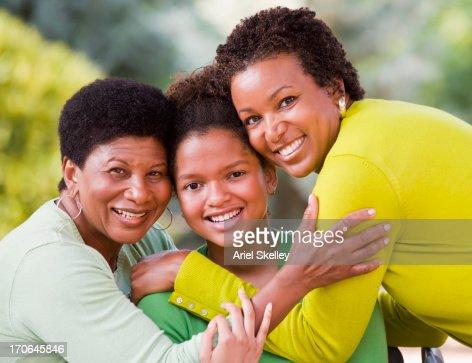Three generations of Black women smiling : Stock Photo
