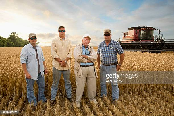 Three generations of Caucasian farmers in crop field