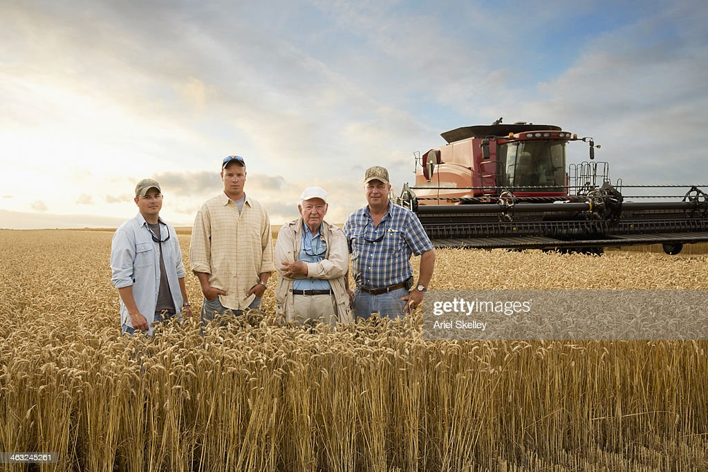 Three generations of Caucasian farmers in wheat field