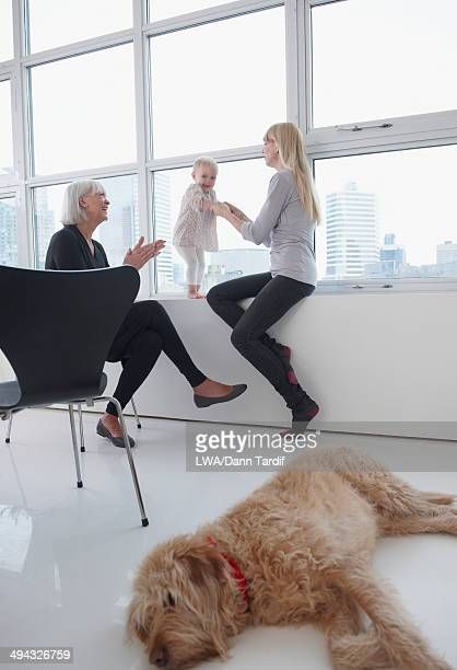 Three generations of Caucasian women by window