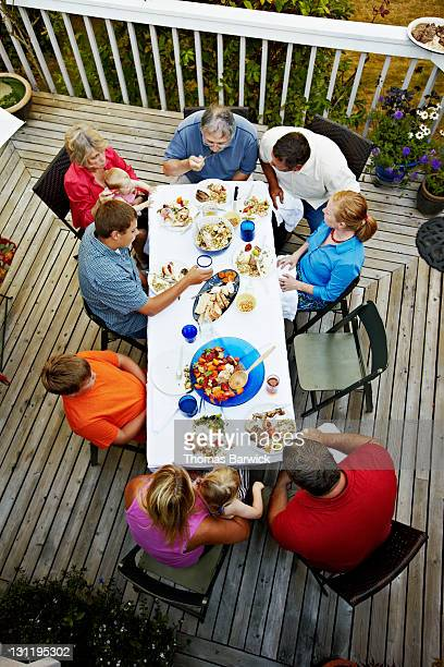 Three generations of family sitting at table