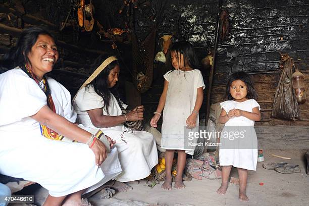 Three generations of female Arhuacos seen inside a hut on January 23 2015 in Nabusimake Colombia Nabusimake is the spiritual center of the Arhuaco...