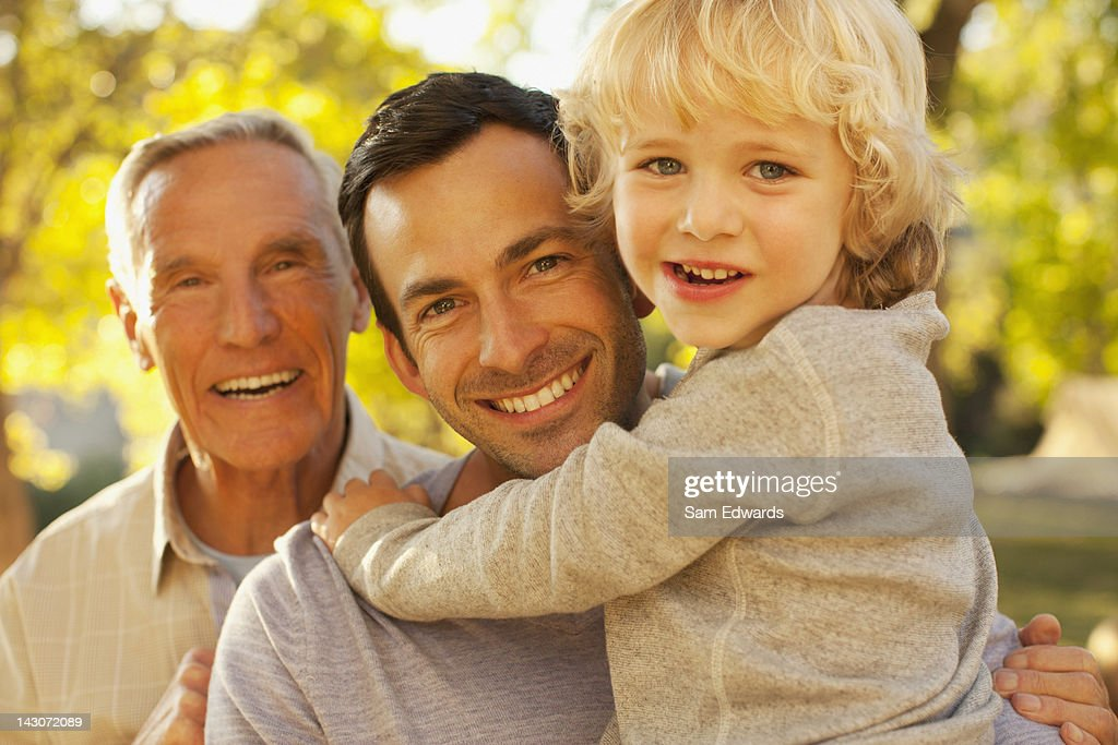 Three generations of men smiling together : Stock Photo