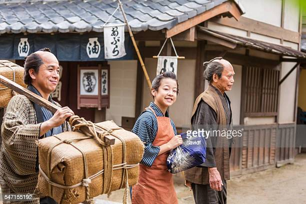 Three Generations of Tradional Japanese Farmers Taking Produce to Market
