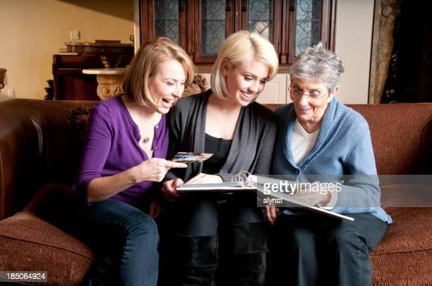 Three Generations of Woman Looking At Family Photos