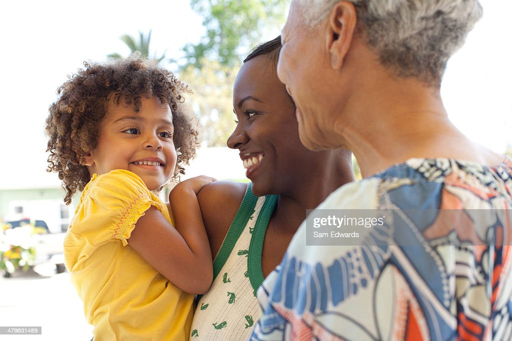 Three generations of women bonding outdoors : Stock Photo