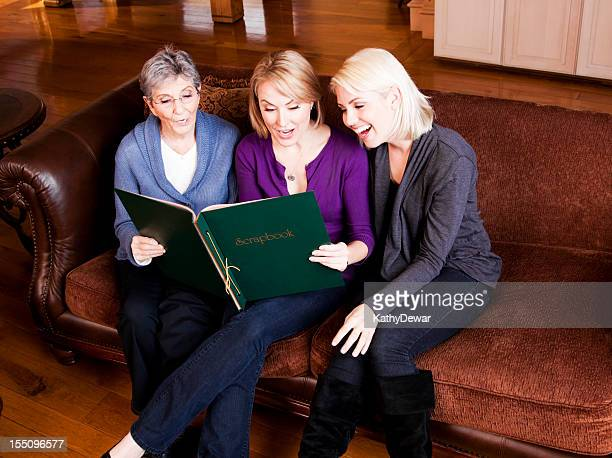Three Generations of Women Looking through a Scrapbook