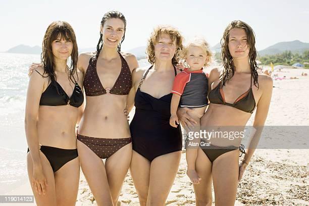 Three generations of women on beach