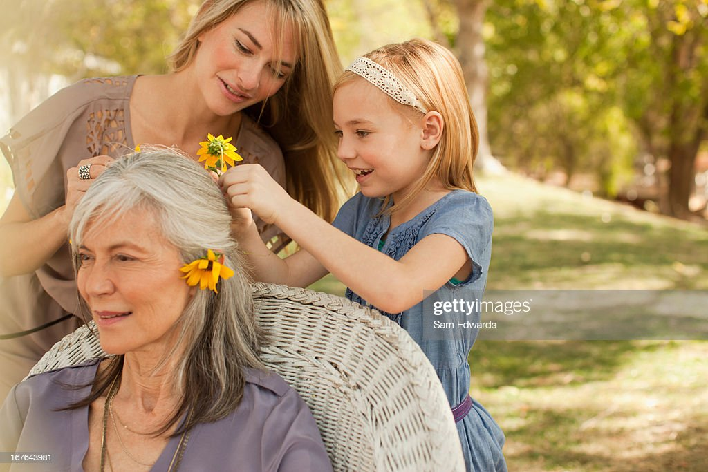 Three generations of women playing outdoors : Stock Photo