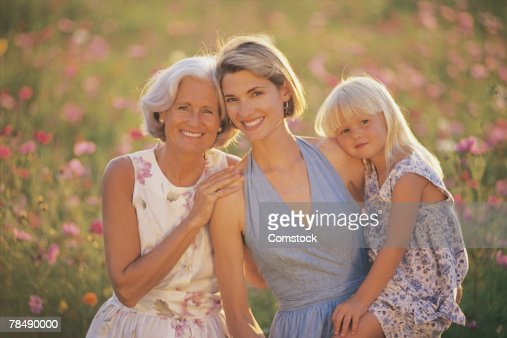 Three generations of women posing outdoors : Stock Photo