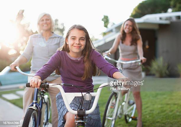 Three generations of women riding bicycles