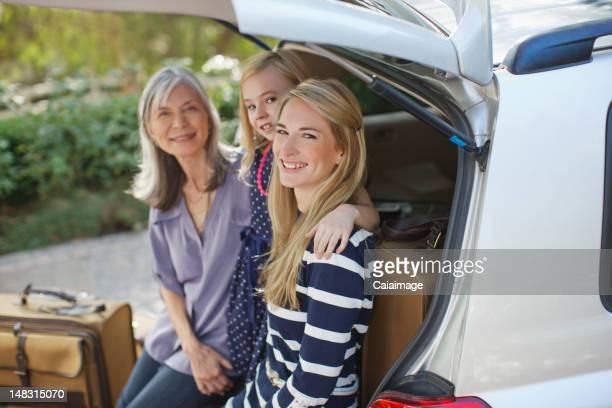 Three generations of women sitting in car