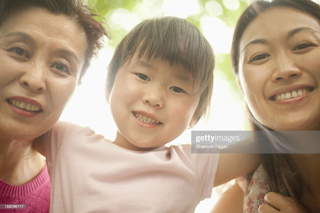 Three Generations of Women Smiling at Ditan Park : Stock Photo