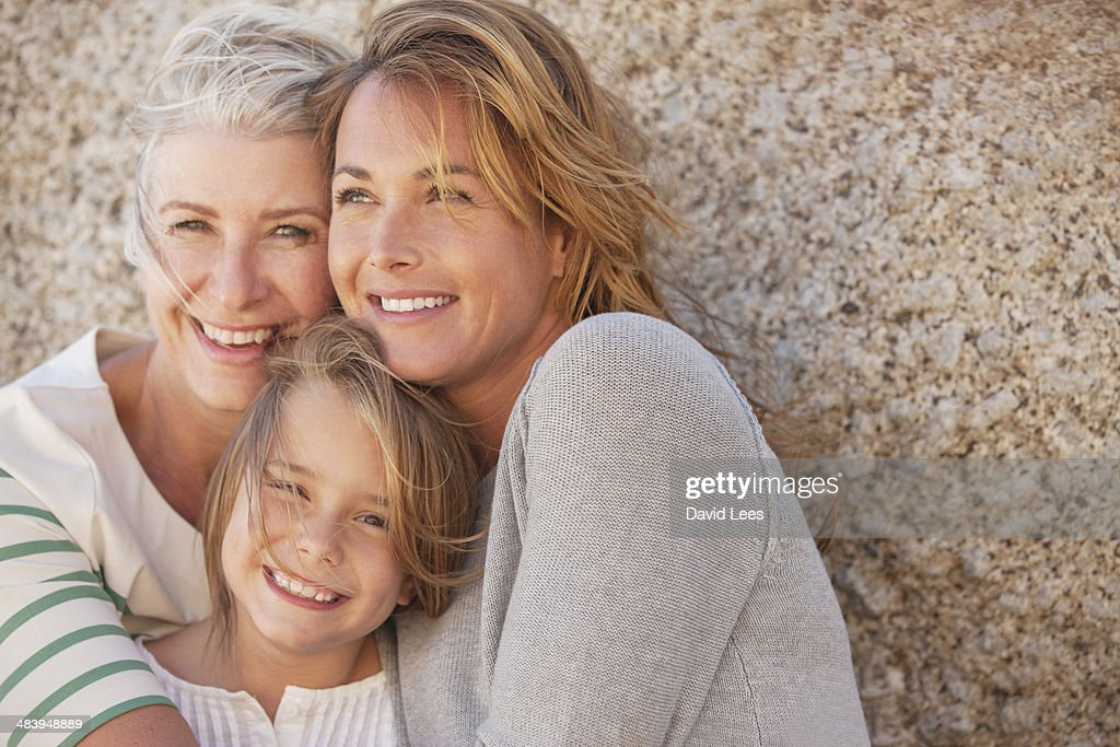 Three generations of women smiling outdoors : Stock Photo