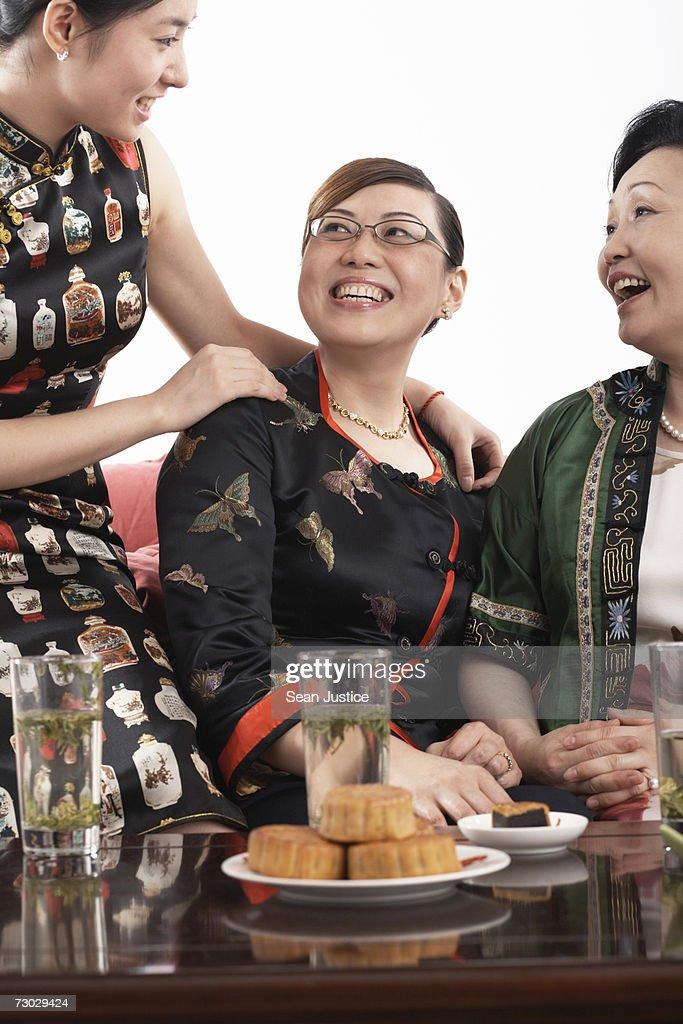 Three generations of women smiling : Stock Photo