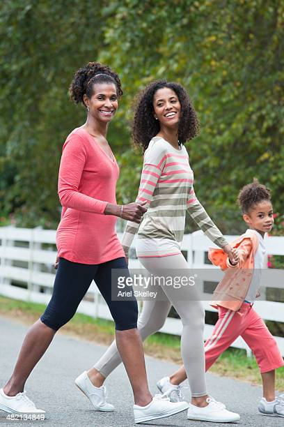 Three generations of women walking outdoors