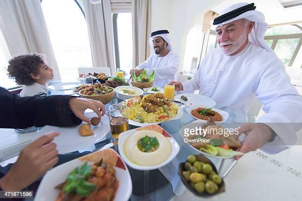 Three Genration Arabic family Enjoying lunch