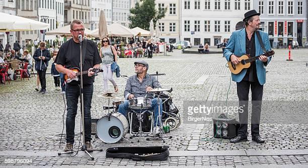 Three gentlemen entertaining in Nytorv, Copenhagen, Denmark