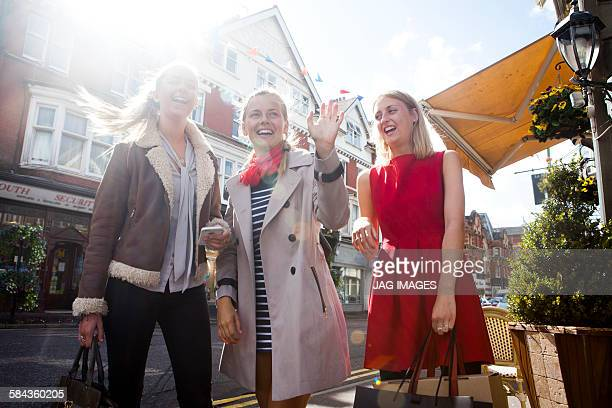 Three girl friends enjoying lunch and shopping