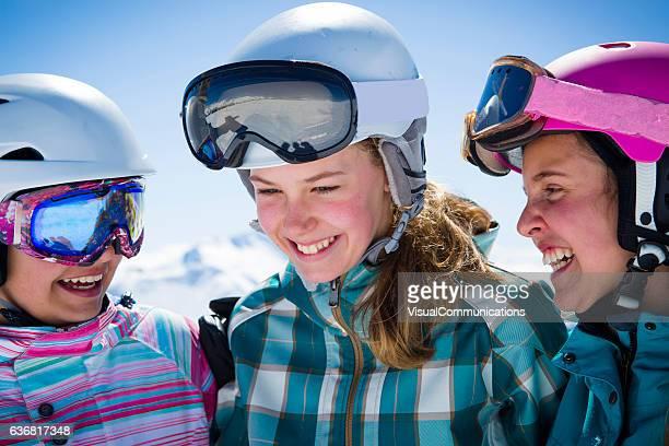 Three girl friends in ski gear.