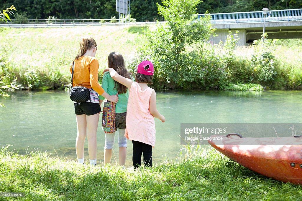 Three girls beside a lake : Stock Photo