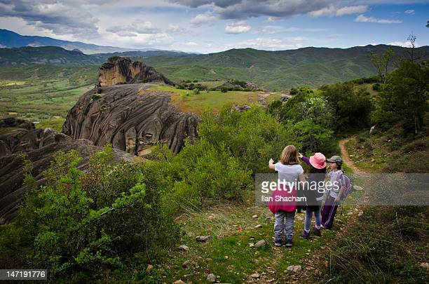 Three girls enjoying view while hiking