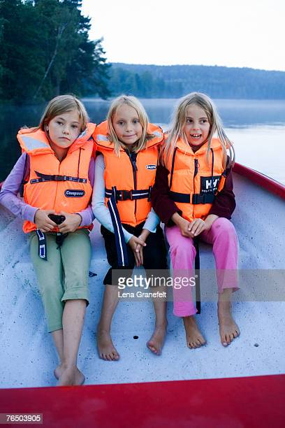 Three girls in a boat.