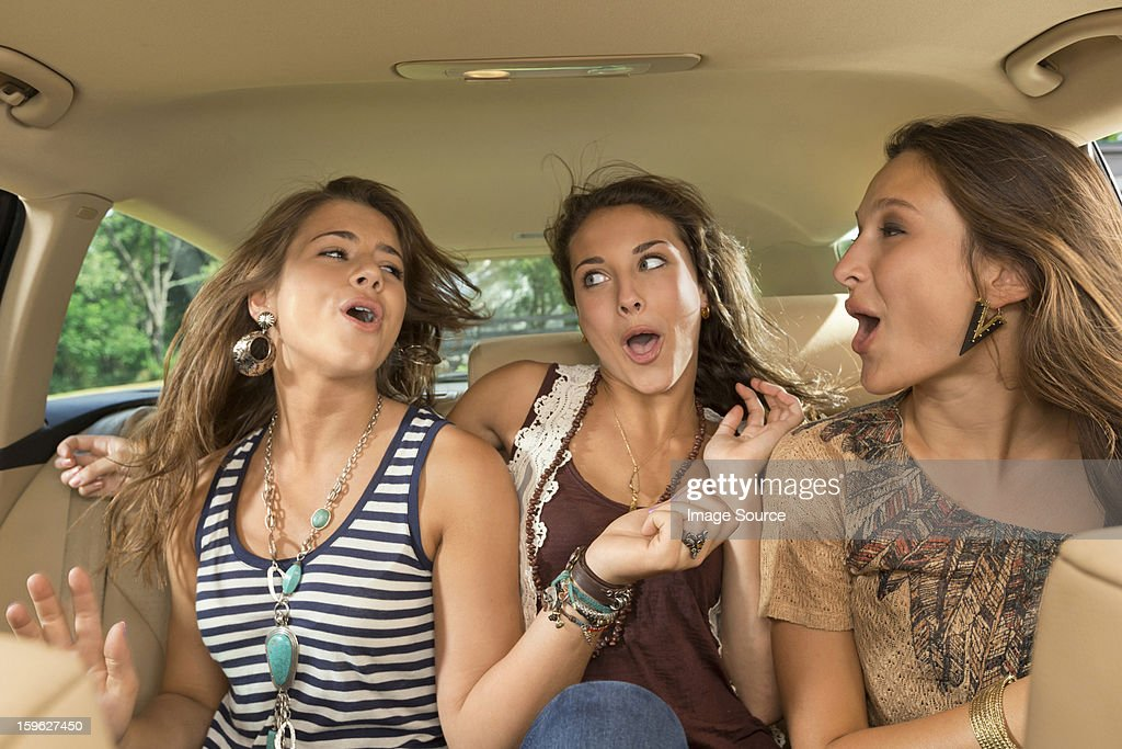 Three girls in back seat of car