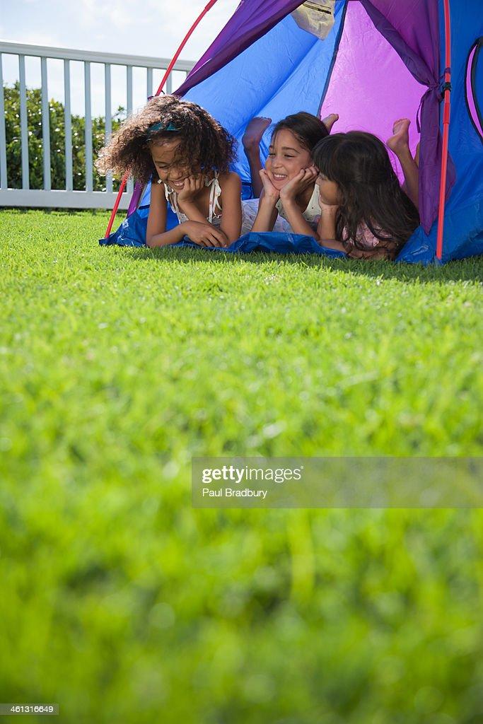 Three girls in tent : Stock Photo
