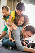 Three girls on top of father