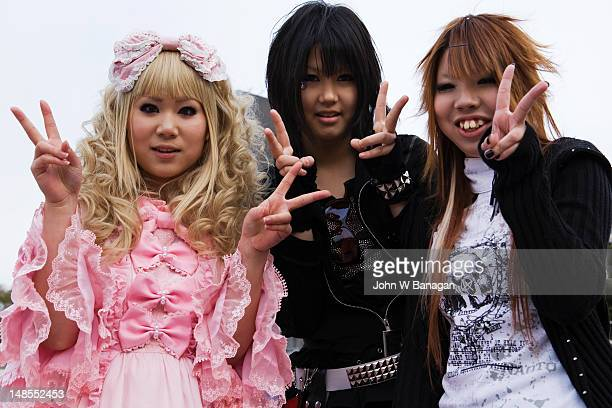 Three girls posing - teenage street fashion, Harajuku district.