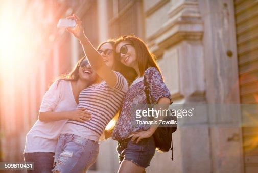Three Girls Taking a Selfie : Stock Photo