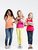 Three girls using technology