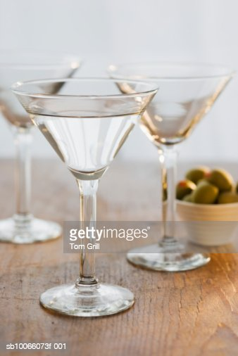 Three glasses of martini with olive, close-up : Stock Photo