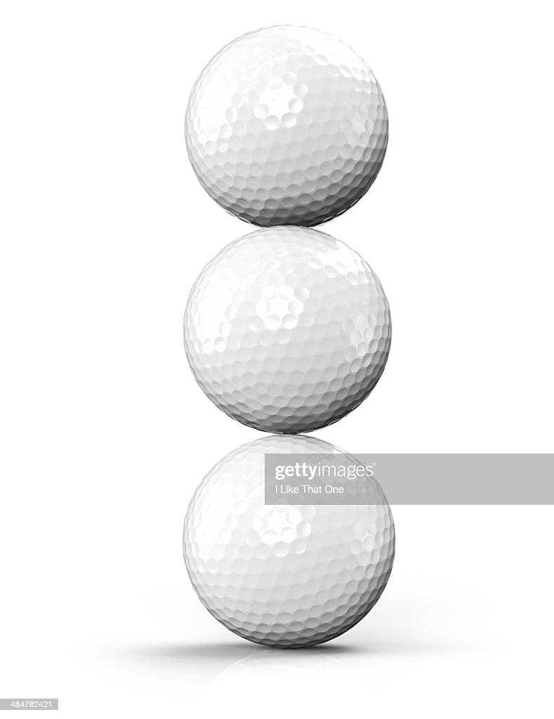 three golf balls stacked ontop of each other stock photo getty