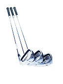 Three golf clubs on white background